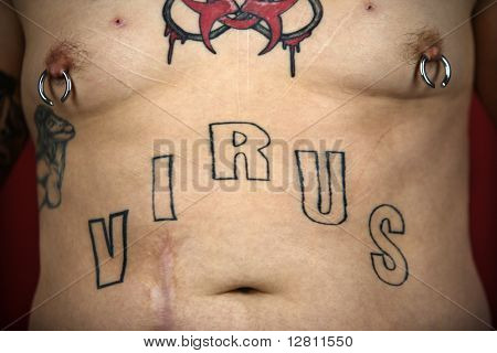 Caucasian mid-adult man midriff with tattoos and piercings.