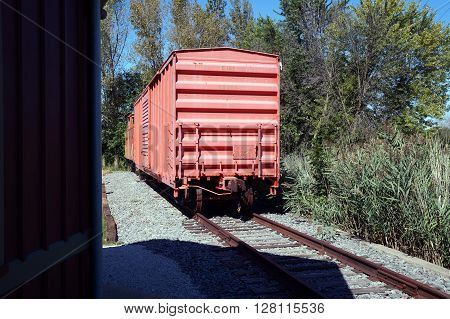 PLAINFIELD, ILLINOIS / UNITED STATES - SEPTEMBER 20, 2015: An old boxcar of the former Elgin, Joliet and Eastern (EJ&E) Railway sits on a railroad track in Plainfield.