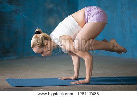 Beautiful Sporty Young Woman Doing Bakasana