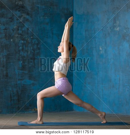 Beautiful Sporty Young Woman Doing High Lunge Pose