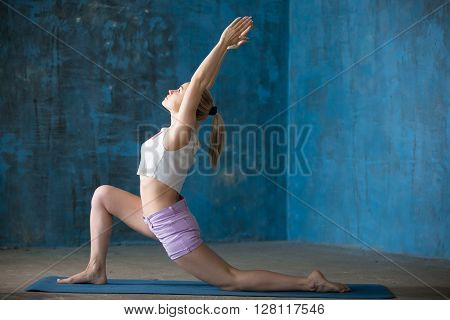 Beautiful Sporty Young Lady Doing Anjaneyasana Posture