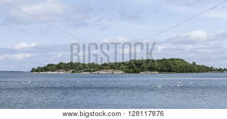Islands in the archipelago, Aland, The Baltic Sea. Rocks, cliffs and forests.