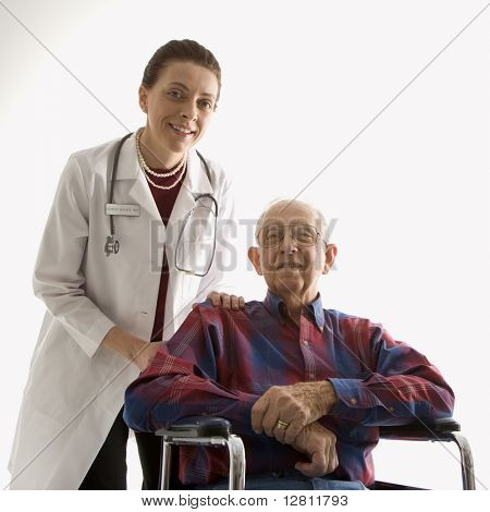 Mid-adult Caucasian female doctor with hands on elderly Caucasian male's shoulder in wheelchair.
