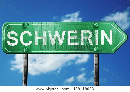 Schwerin road sign, 3D rendering, vintage green with clouds back