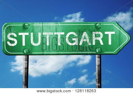 Stuttgart road sign, 3D rendering, vintage green with clouds bac