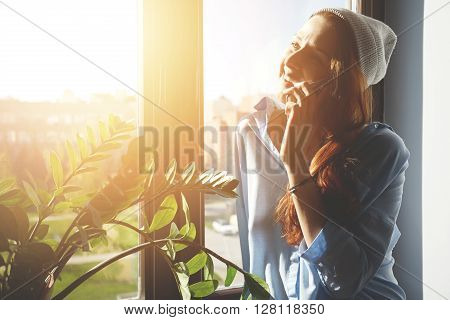 Headshot Of Redhead Caucasian Student Girl Talking On Smart Phone To Friends Discussing Plans On The