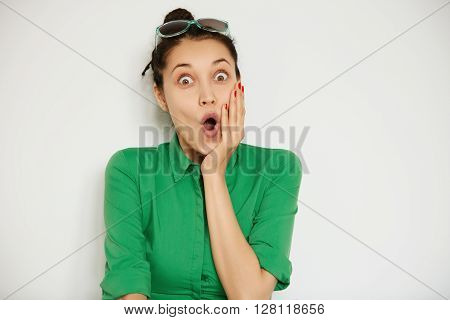 Close-up Portrait Of Surprised Beautiful Student Girl Holding Her Head In Amazement And Wide-open Mo