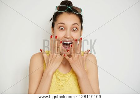 Cropped Isolated Shot Of Happy Young Brunette Female Wearing Bun And Yellow Top, Looking And Screami