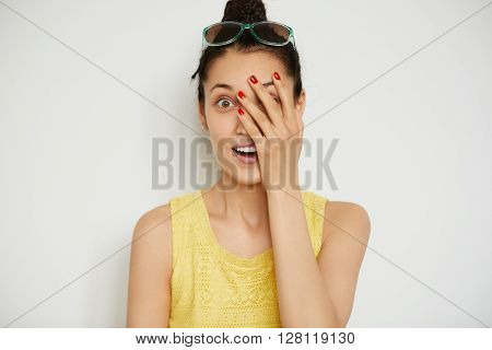 Cropped Shot Of Surprised Young Brunette Female In Casual Top Covering Her Face In Astonishment Whil