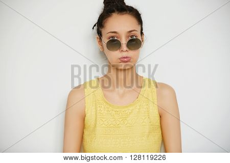 Close Up Isolated Portrait Of Upset Young Dark-haired Woman In Sunglasses And Stylish Top Looking At