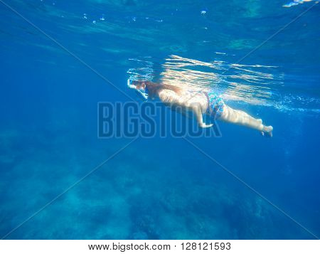 Woman swimming in blue  sea, Beautiful woman under water before dive to coral reef, woman snorkeling in blue mask, tropical sea snorkeling, summer vacation activity, girl swimming, sea