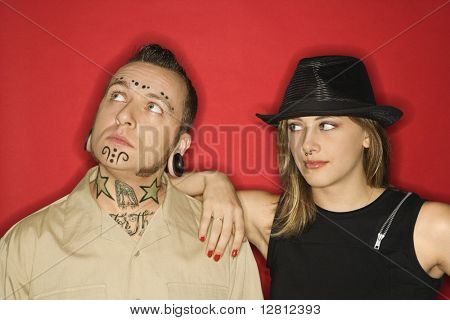 Caucasian teen female looking at mid-adult man who is looking away.