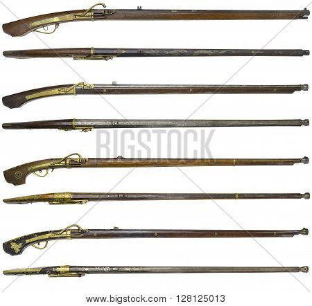 Antique rifle firearms guns on a white background.