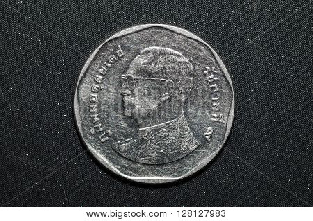 5 thai baht coin on black color background