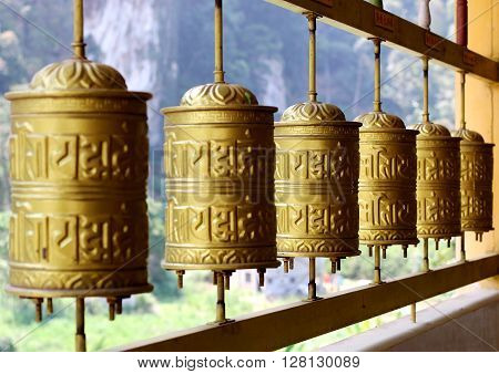 Buddhist prayer wheels which are prominent in a Tibetan temple or monastery.