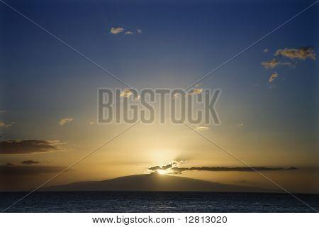 Sunset over the coast of Kihei, Maui, Hawaii, USA.