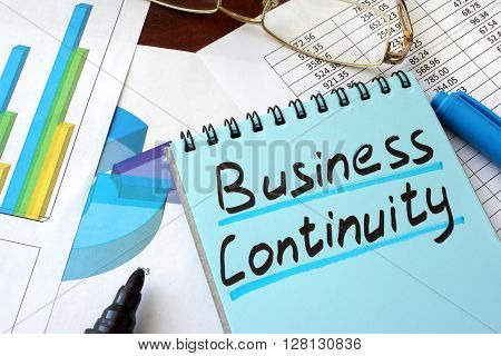 Business Continuity written on a notepad with marker.
