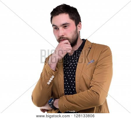 Bearded puzzled man in jacket on white background