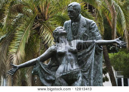 Statue of novelist Eca de Queiros with female muse in Lisbon, Portugal.
