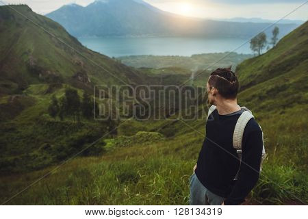 Modern Hiker Man Looking At Sunrise On The Mountain,freedom Concept. Ascent To The Volcano,travel Gu