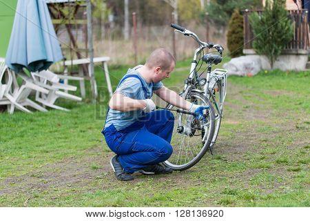 Man pumping wheel bike. preparation for the bike season