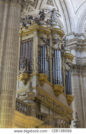 Jaen, Spain - may 2016 2: Monumental main organ inside the choir is one of the biggest of Spain, The organ this insert in baroque structure, is the work of Jose Garcia and Manuel Lopez (1870), Jaen, Spain