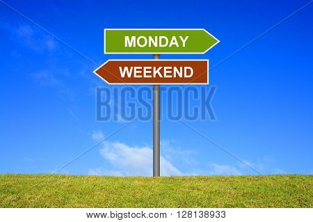 Sign with two arrows shows Weekend and Monday