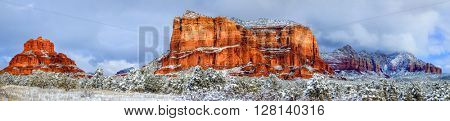 Panoramic view of Courthouse Butte and Bell Rock in Sedona, Arizona after snow storm