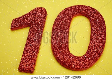 Number ten red color over a yellow background. Anniversary. Horizontal ** Note: Soft Focus at 100%, best at smaller sizes