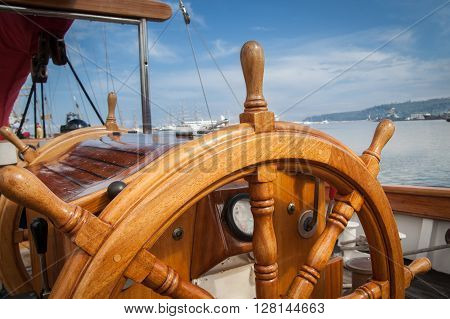 Old boat steering wheel from wood. Travel