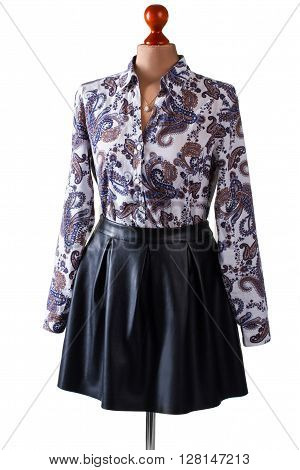 Black leather skirt and shirt. Skirt and shirt on mannequin. Woman's casual evening outfit. Stylish spring apparel on sale.