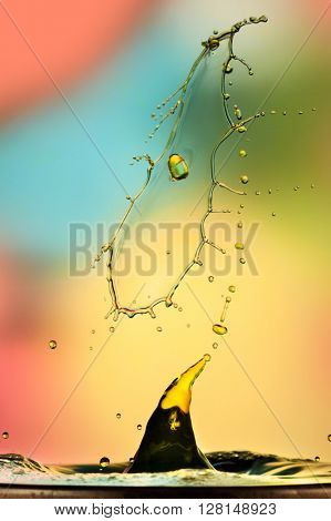 Extreme close-up image of splash, drop collision with abstract look