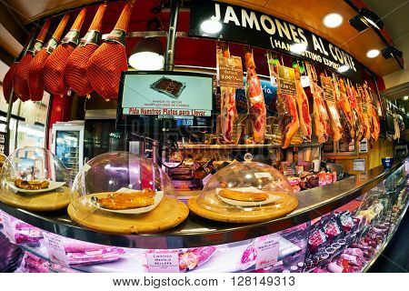 MADRID, SPAIN - NOVEMBER 11, 2015 : Well known bar and market Museo de Jamon in Madrid.  Jamon (Spanish word for ham) traditional meat in spanish cuisine.