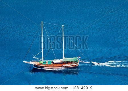The white yacht in the blue sea