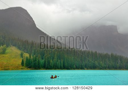 Emerald lake with fog in Yoho National Park, Canada.