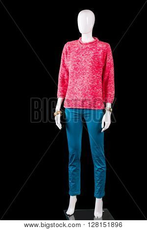 Pink pullover with tuquoise pants. Pants and pullover on mannequin. Colorful outfit on dark background. Lady's comfortable spring clothes.