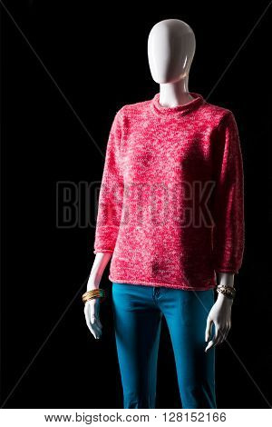 Pink sweatshirt and turquoise pants. Mannequin in pants and sweatshirt. Colorful spring outfit for girls. Huge discounts at fashion store.