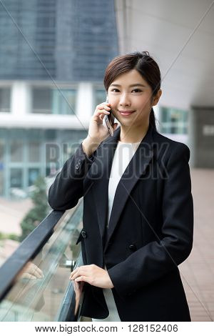 Business woman talking on smart phone in Hong Kong