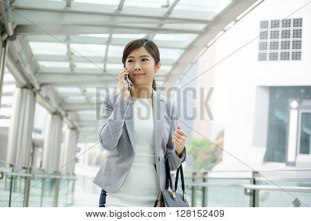 Businesswoman using smartphone in Hong Kong