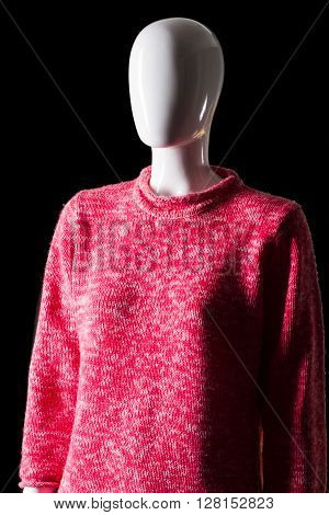 Casual pink sweatshirt. Female mannequin in pink sweatshirt. Girl's warm woolen clothing. Colorful spring clothes on display.