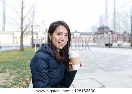 Woman drinking coffee at outdoor