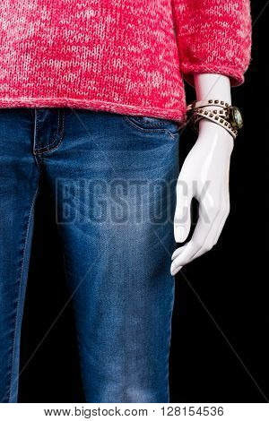 Small watch and blue jeans. Mannequin in jeans with watch. Lady's trendy watch on sale. Fashionable accessory at low price.