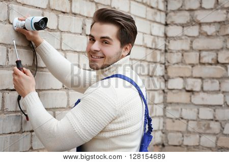 Professional CCTV technician working.