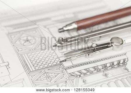 compasses, mechanical pencil and architectural drawing