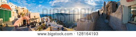 Oia, Greece - March 06, 2016 : Panorama of Oia sunset, one of the most beautiful places in Santorini at sunset
