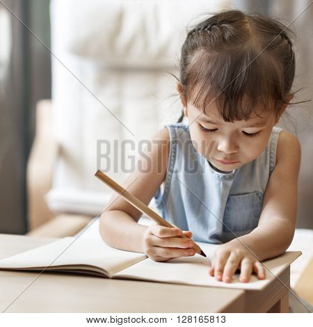 Cute Little Girl Writing Drawing Concept