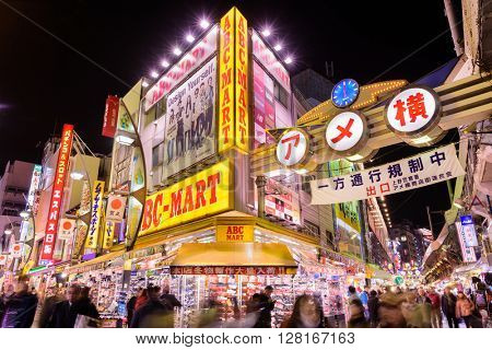 TOKYO, JAPAN - DECEMBER 28, 2015: Crowds at Ameyoko shopping district of Tokyo. The street was the site of a black market in the years following World War Two.