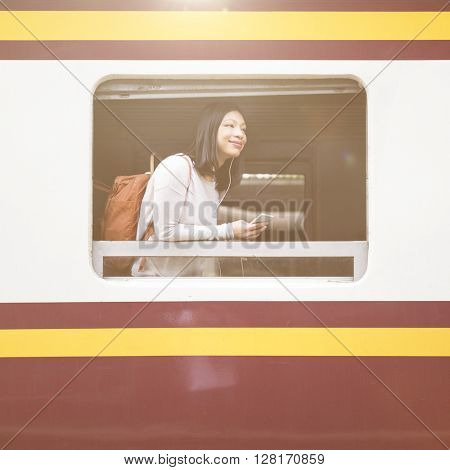 Asian Lady Traveling Commute Train Concept