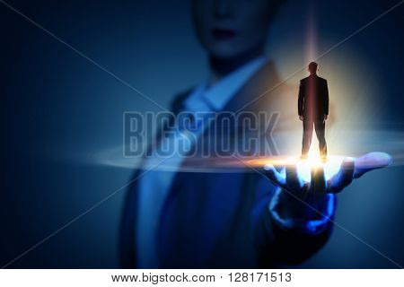 Miniature of businessman in palm