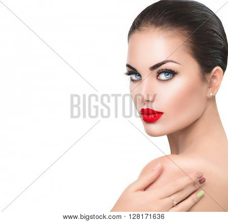 Beauty Fashion Model Woman face. Sexy Girl Portrait with Red sexy lips and blue eyes, perfect make up. Beautiful Brunette Female with Luxury Makeup touching her soft skin. Skin care. Isolated on white